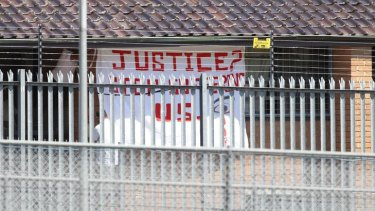 A protest flag is displayed at Villawood detention centre last year.