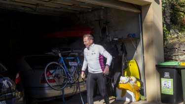 Tony Abbott returns home after a bike ride and a swim on Sunday.