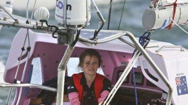 Jessica Watson sails into Sydney Heads.