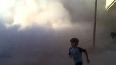 This frame grab  from an amateur video provided by Syrian activists on Monday, purports to show a boy running during the massacre in Houla on May 25. AP has been unable to verify its authenticity.