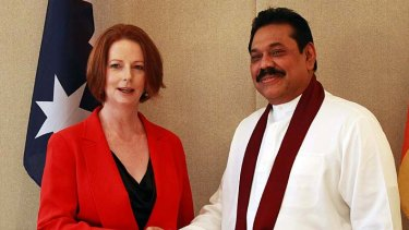 Mahinda Rajapaksa … the Sri Lankan President shakes hands with Julia Gillard.
