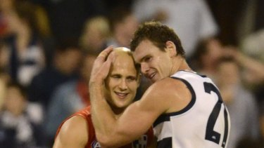 Still feeling the love: Gold Coast's Gary Ablett and his former teammate, Geelong's Cameron Mooney.