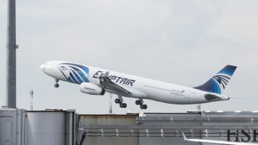 An EgyptAir Airlines passenger jet takes off from Charles de Gaulle airport on Thursday.
