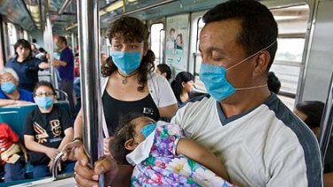 Taking no chances . . . Mexican commuters wear face masks to reduce the chance of infection.