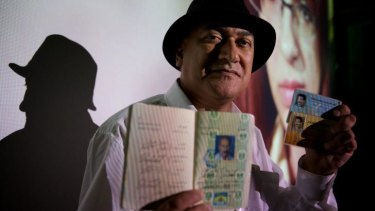 Poet Jamal Ali Al Hallaq with his fake passport and documents which helped him escape from Iraq.