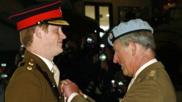 Flying high... Prince Harry was awarded his helicopter pilot's wings by his father Prince Charles at the Army Aviation Centre in Middle Wallop.