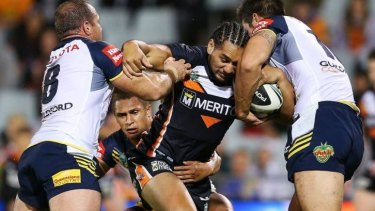 Clinical: Martin Taupau of the Tigers goes into contact.