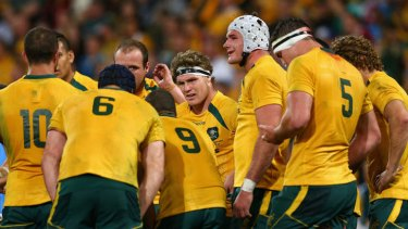 Looking for answers: Michael Hooper, centre, and Wallabies teammates during the loss to the Springboks in Brisbane earlier this month.