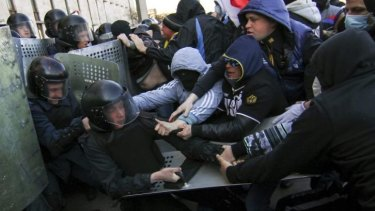 """""""Disorder"""": Pro-Russia protesters scuffle with police."""