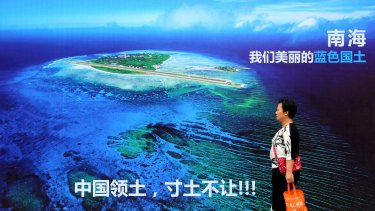 "A billboard with words that read: ""South China Sea, our beautiful motherland, we won't let go an inch"" in east China's Shandong province."