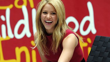 Shakira ... charity with a smile.