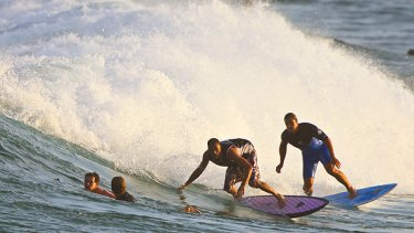 Heavy traffic ... Surfers compete for a wave at Manly yesterday.