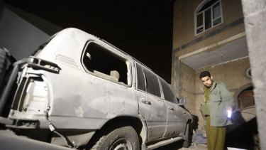 A Houthi militant checks the site of a bomb explosion near a military academy in Sanaa on Monday. A French woman and her driver were abducted at gunpoint in the capital on Tuesday, according to reports.