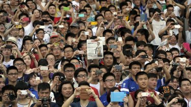 Chinese fans cheer as  David Beckham makes an appearance at Nanjing on June 18. Beckham is an ambassador for the China Super League.