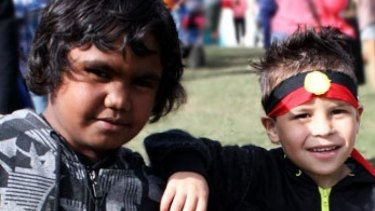 Two children enjoy themselves during the 2013 Musgrave Park Family Fun Day.