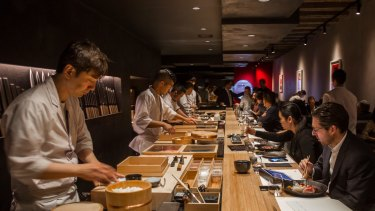 Chefs at Kisumé's sushi bar face the diners.
