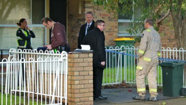 Investigators at the scene of the Heidelberg Heights fire.