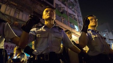 Police armed with batons in Mong Kok on Sunday morning.