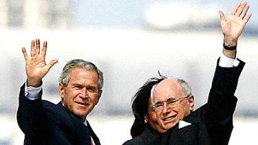 US President George Bush and former prime minister John Howard tour Sydney Harbour in 2007.