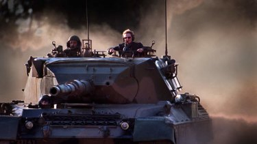 As minister for defence industry, Bronwyn Bishop leads the charge in a Leopard Tank at Puckapunyal Army Base during a visit in 1997.
