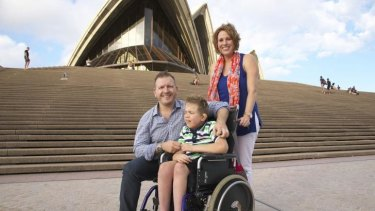 """""""Not ideal"""": Accessing the Sydney Opera House can be a long-winded process, says president of the Association for Children with a Disability, Timothy Smith, left, with son Marcus, 8, and wife Caroline."""