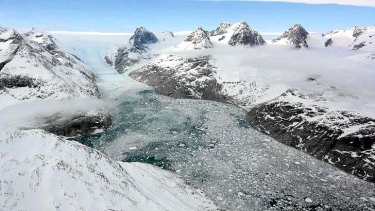 A NASA Earth Observatory image of a glacier in eastern Greenland carved by the movement of ice.