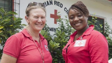 Nurse Libby Bowell with a colleague in Liberia.