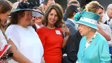 Pointy hat ... Gina Rinehart, second left, meets the Queen.