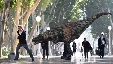 It's alive!: A Tyrannosaurus-rex taking a morning stroll with commuters in Hyde Park.