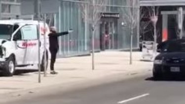 A man confronts police in Toronto after a van ran into pedestrians, killing nine people.