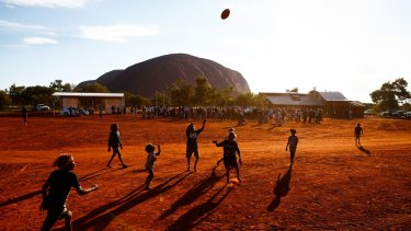 Voices heard: Children playing football during the closing ceremony in the Mutitjulu community of the First Nations National Convention held in Uluru on May 26.