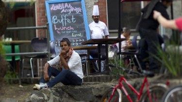 Shanaka Fernando and head chef Errol Schwallie at Lentil as Anything yesterday.