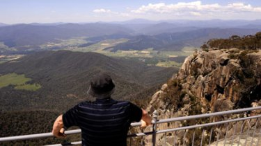 View from the top: A sightseer takes in the spectacular alpine scenery  from  one of the viewing platforms near the Mount Buffalo Chalet.