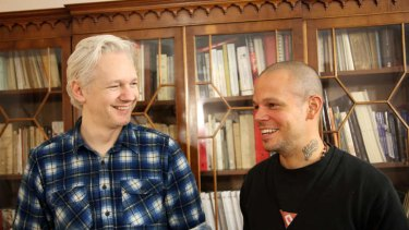 This June 12, 2013 photo released by Calle 13 shows Rene Perez Joglar, better known as, Residente, from the Latin music group Calle 13, right, and WikiLeaks founder Julian Assange during a songwriting session at the Ecuadorian embassy in London.