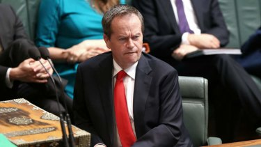 Opposition leader Bill Shorten listens to Prime Minister Tony Abbott on Wednesday.