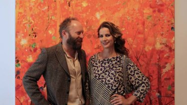 """""""I'm playing an underemployed artist's wife"""" ... Rachel Griffiths and Andrew Taylor at the opening of his exhibition."""