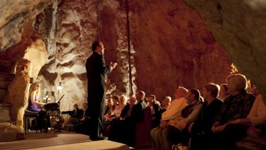 Captive crowd … the opera singer Douglas McRae performs in the Capricorn Caves in Rockhampton for the Underground Opera Company.