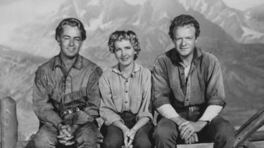 Alan Ladd as Shane and Jean Arthur and Vann Heflin as the Starretts in <i>Shane</i>. Note how Ladd seems tall til you compare leg lengths.