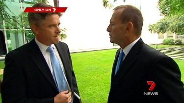 A dramatic pause: Tony Abbott nods at Mark Riley.