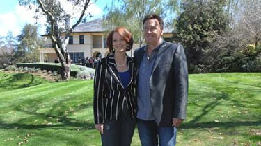 Julia Gillard and Tim Mathieson take a stroll around The Lodge's gardens.
