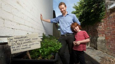Caring and sharing: HerbShare founder Ben Hart and his son Oscar, 8, check out their herb crop in the lane behind their house.