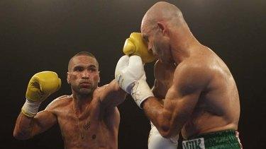 Anthony Mundine gets through the defences of his opponent, Rigoberto Alvarez.