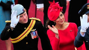 A wave to the crowd ... Britain's Duchess of Cambridge, her husband the Duke of Cambridge, right, and Prince  Harry.