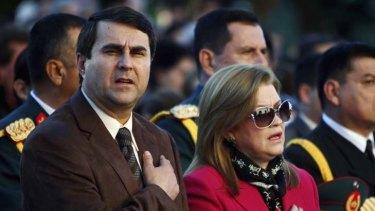 Paraguay's new President, Federico Franco, and his wife, Emilia Alfara, attend Mass in Asuncion.