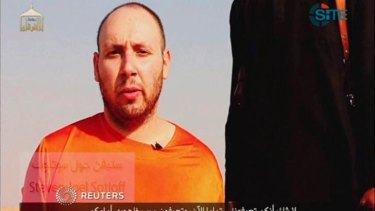 HORROR: Journalist Steven Sotloff is seen in a still image from a video released by the Islamic State, purporting to show his beheading.