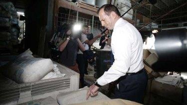 Liberal leader Tony Abbott visits a Brisbane home insulation business.