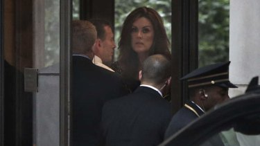 Prime Minister Tony Abbott and his chief-of-staff Peta Credlin arrive in the lobby of Rupert Murdoch's Central Park apartment in New York for dinner with the media mogul.