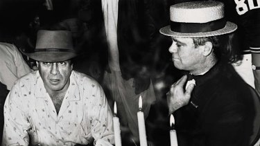 Don't go breaking my heart  … Molly Meldrum with Elton John in 1986.