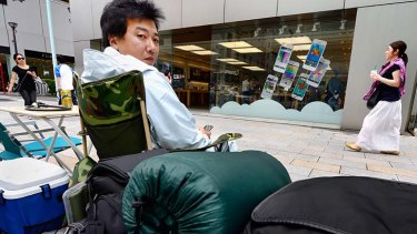 A man queues up in front of an Apple Store to buy the new iPhone 5s.