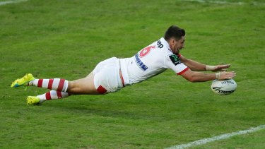 Gareth Widdop of the Dragons scores against the Roosters.